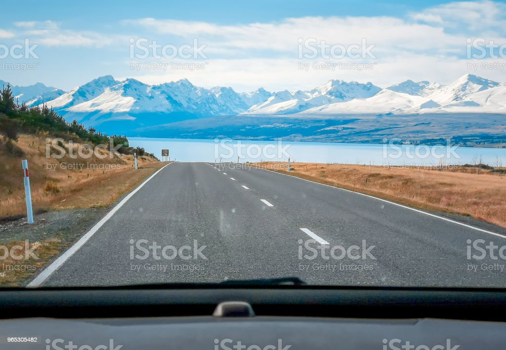 A view of the beautiful New Zealand landscape from inside a car on a road trip royalty-free stock photo