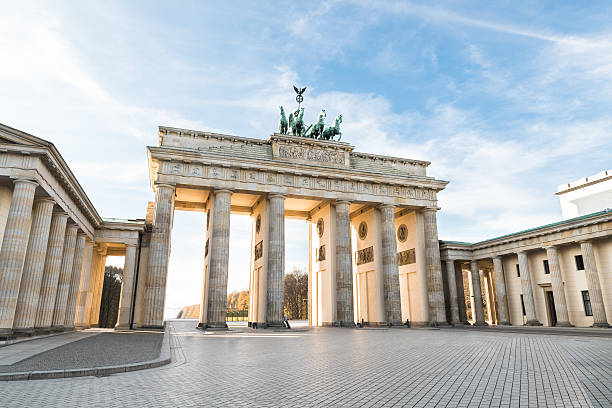 view of the brandenburger tor and courtyard in berlin - berlin street bildbanksfoton och bilder