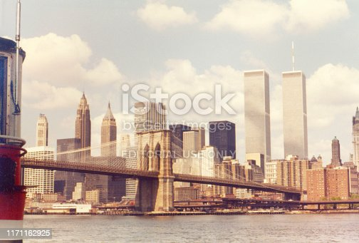NEW YORK, NY, USA. APRIL 1980. Vintage 1980s view of the Brooklyn Bridge with Manhattan financial district and the Twin Towers.