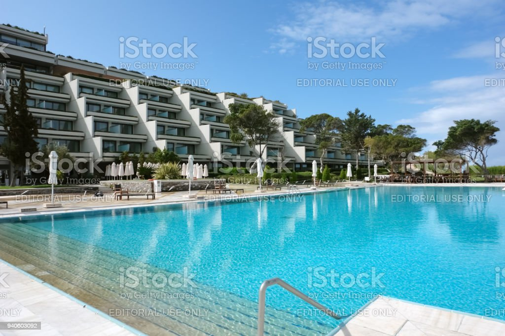 View of the building of a modern luxury hotel and a large pool in Creece. stock photo