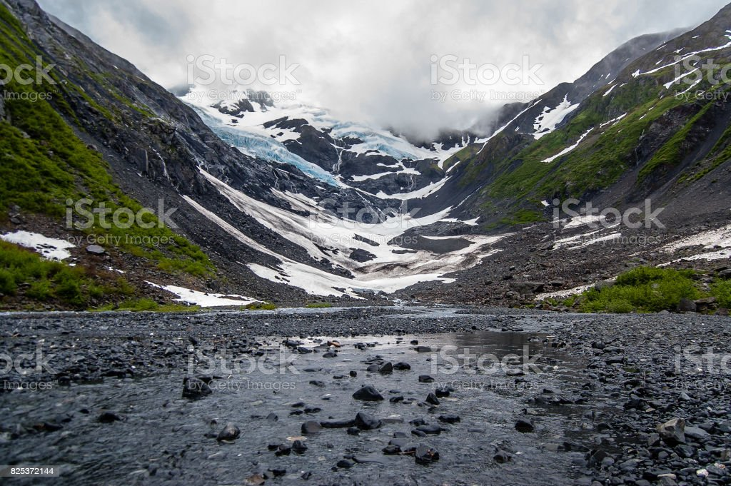 View of the Byron Glacier and Byron creek with stones stock photo