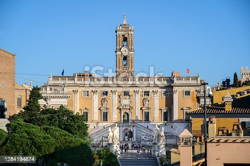 A view of the facade and the square of the Campidoglio (Capitoline Hill) in the heart of Rome, with the bronze copy of the majestic equestrian statue of Emperor Marcus Aurelius in the center. The square and the palace was designed by Michelangelo Buonarroti. The original statue of Marcus Aurelius is kept inside the Capitoline Museums. Currently the Campidoglio is the seat of the Municipality of Rome. Image in High Definition format