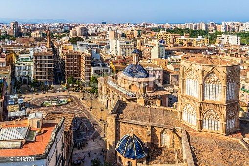 View of the Cathedral Santa Maria of Valencia, the Basilica de la Virgen de los Desamparados and Plaza de la Virgen with Fuente del Turia, Valencia, Spain
