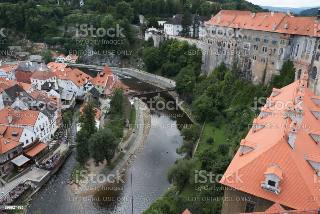View of the charming medieval town, Cesky Krumlov, from the castle tower looking down on the Vltava River in historic red roofed town of Cesky Krumlov. stock photo