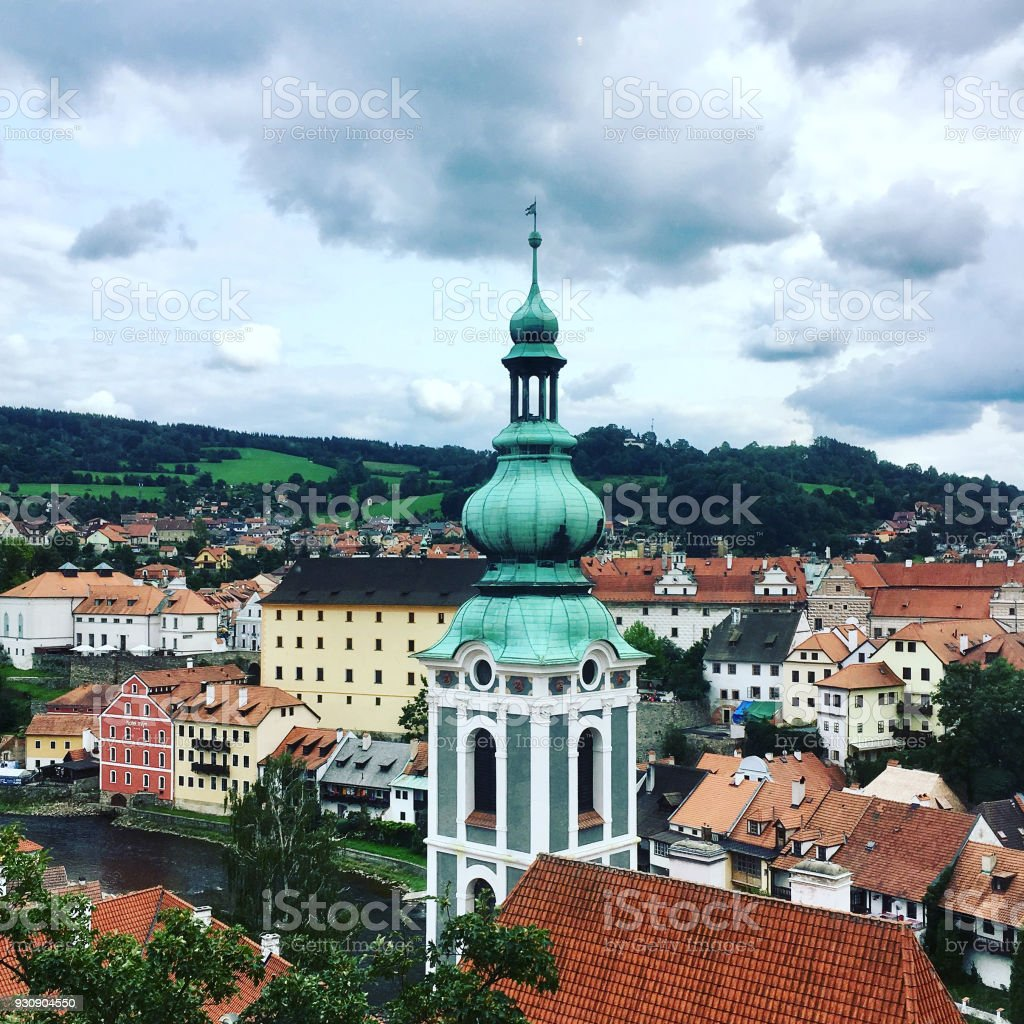 View of the charming medieval town, Cesky Krumlov, from the castle tower. Looking over the town from high up, Church of St Jost overlooking the Vltava River, filter added. stock photo