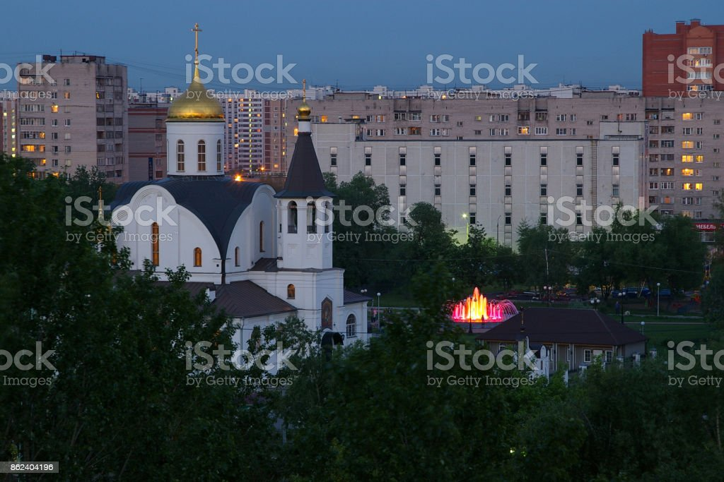 View of the church of the Kazan icon of the Mother of God and the fountain in Reutov stock photo
