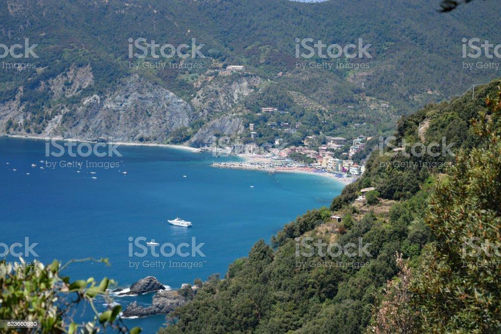 view of the Cinque Terre's rugged coast on the Italian Riviera with  Monterosso al Mare in the distance. Cinque Terre, Italy stock photo