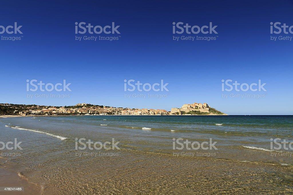View of the citadel from across Calvi bay stock photo