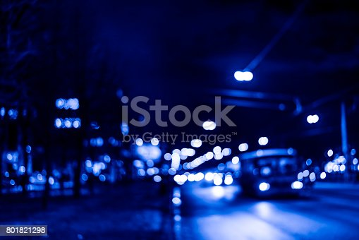 820883024 istock photo View of the city at night after the rain, the bus driving on the road 801821298