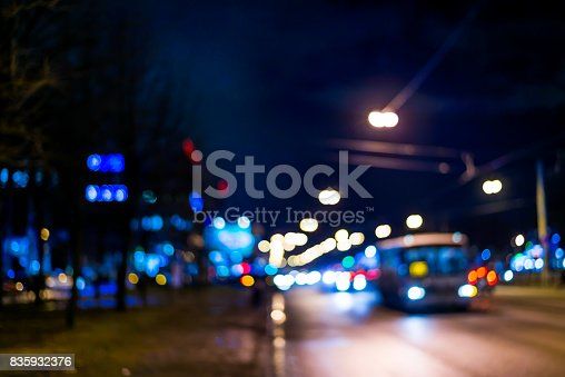 820883024 istock photo View of the city at night after the rain, the bus driving on the road 835932376