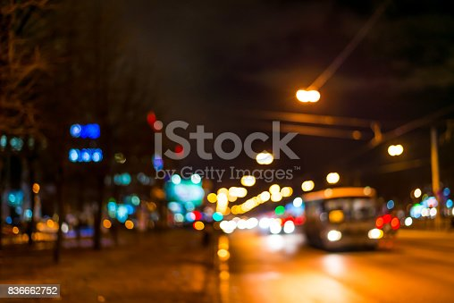 820883024 istock photo View of the city at night after the rain, the bus driving on the road 836662752