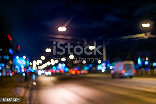 820883024 istock photo View of the city at night after the rain, the car driving on the road. Defocused image 801821324