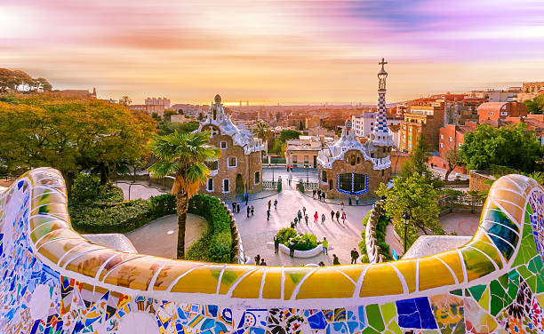 View of the city from Park Guell in Barcelona, Spain View of the city from Park Guell in Barcelona, Spain with moving clouds. barcelona spain stock pictures, royalty-free photos & images