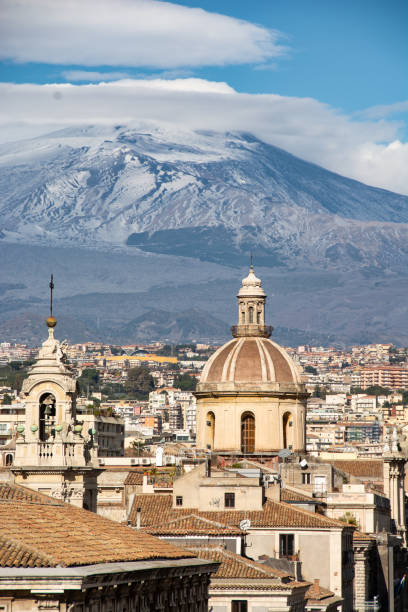 view of the city of Catania with Mount Etna in the background view of the city of Catania with Mount Etna in the background catania stock pictures, royalty-free photos & images