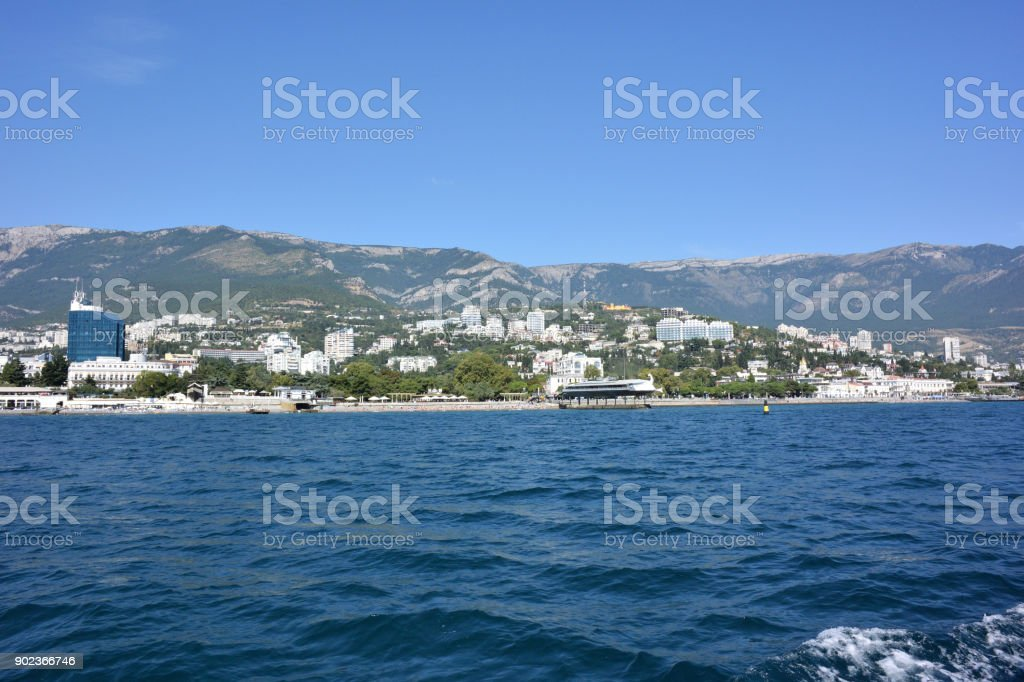 View of the city of Yalta from the sea стоковое фото