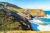 istock View of the cliffs of the cove of La Mina in sunny day, Prellezo 1212355401