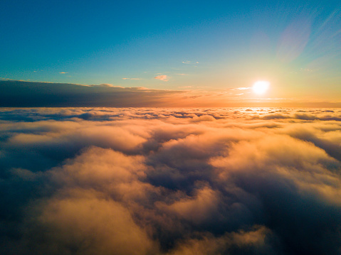 view of the clouds during sunset from above.