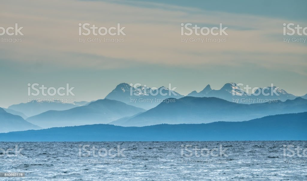 View of the Coast Mountains of continental British Columbia from Vancouver Island, north of Nanaimo. Canada stock photo