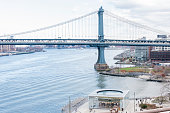 View of the coastline and the Manhattan Bridge from the Brooklyn Bridge at Manhattan, New York, USA.