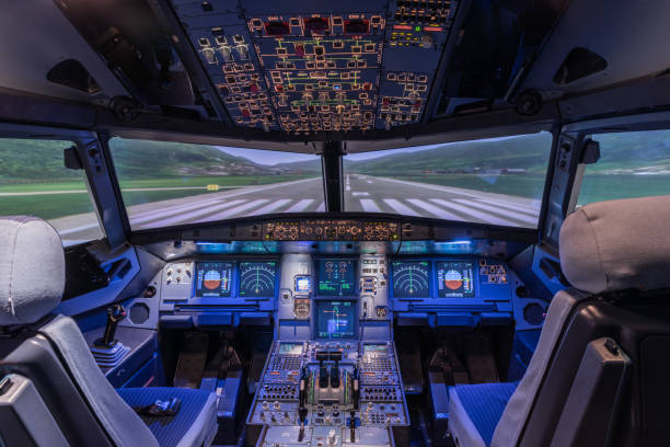 A view of the cockpit of a large commercial airplane, a cockpit trainer. A view of the cockpit of a large commercial airplane, a cockpit trainer. Cockpit view of a commercial jaircraft cruising passenger cabin stock pictures, royalty-free photos & images