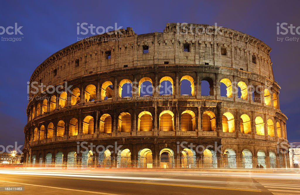 A view of the Coliseum in Italy with blurred traffic stock photo