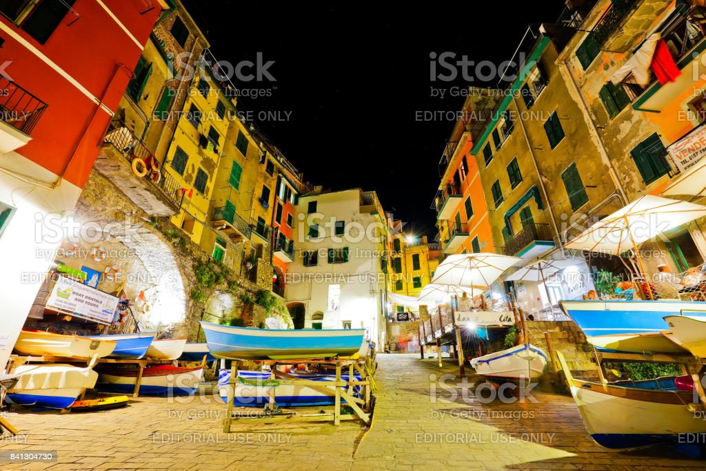 View of the colorful houses at night in Riomaggiore stock photo
