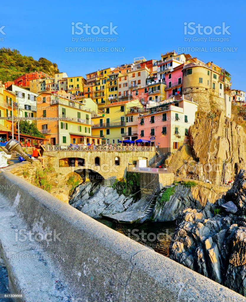 View of the colorful houses at sunset in Manarola stock photo