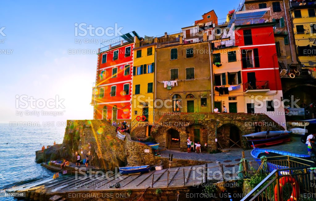 View of the colorful houses in Riomaggiore at sunset stock photo