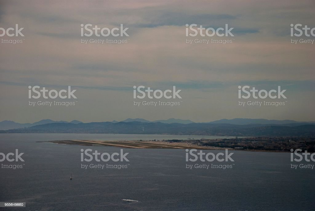 View of the Cote d'Azur Airport (NCE) in Nice from the nearby hills on the French Riviera stock photo