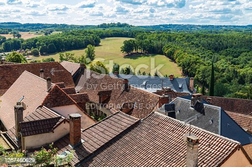 istock View of the countryside over the rooftops in the town of Hautefort. 1257460629