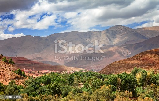 istock View of the desolating valley Ounila River. Beautiful Northern African Landscape . Fascinating view from the hill to the valley in Morocco 1096577950