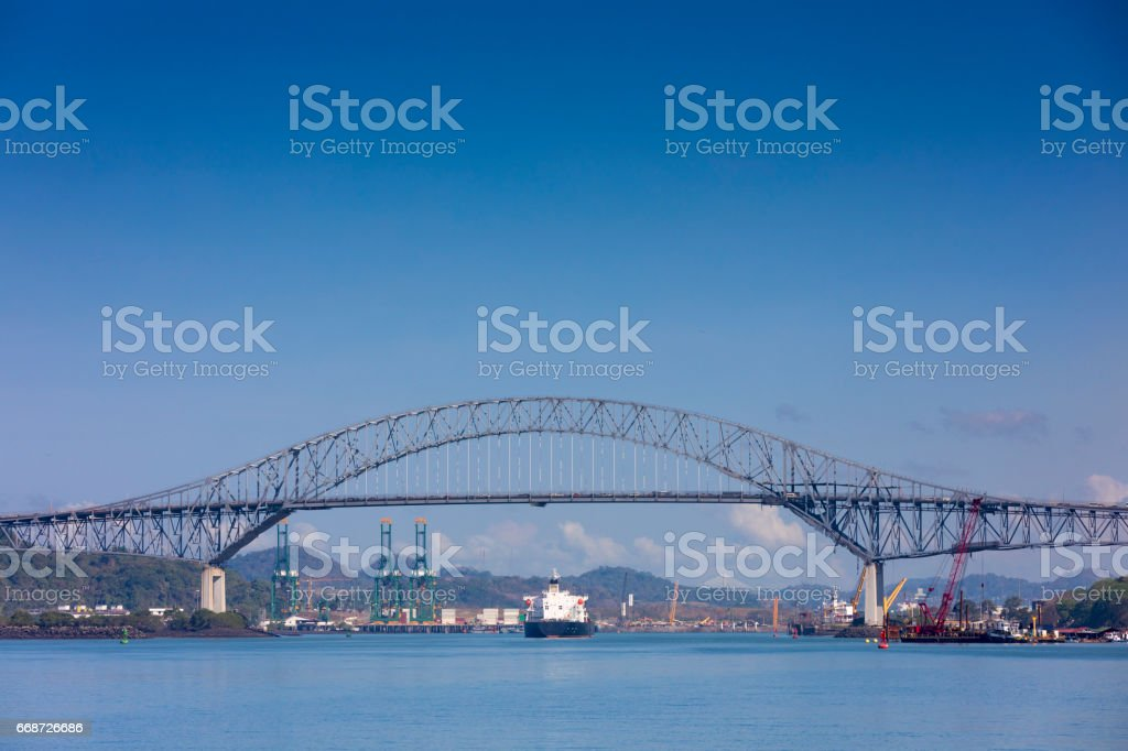 A view of the early morning light on the Pacific ocean and the famous bridge of the Americas, taken from a boat, while on our way to the Panama Canal. stock photo