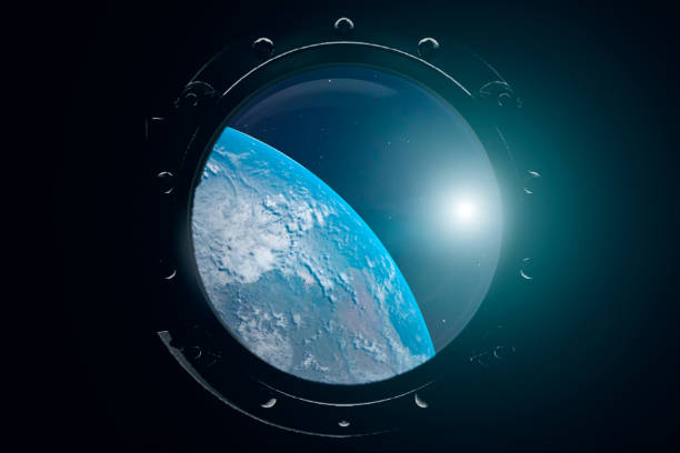 a view of the earth from through the porthole of a spaceship. international space station is orbiting the earth. 3d illustration - исследование космоса стоковые фото и изображения