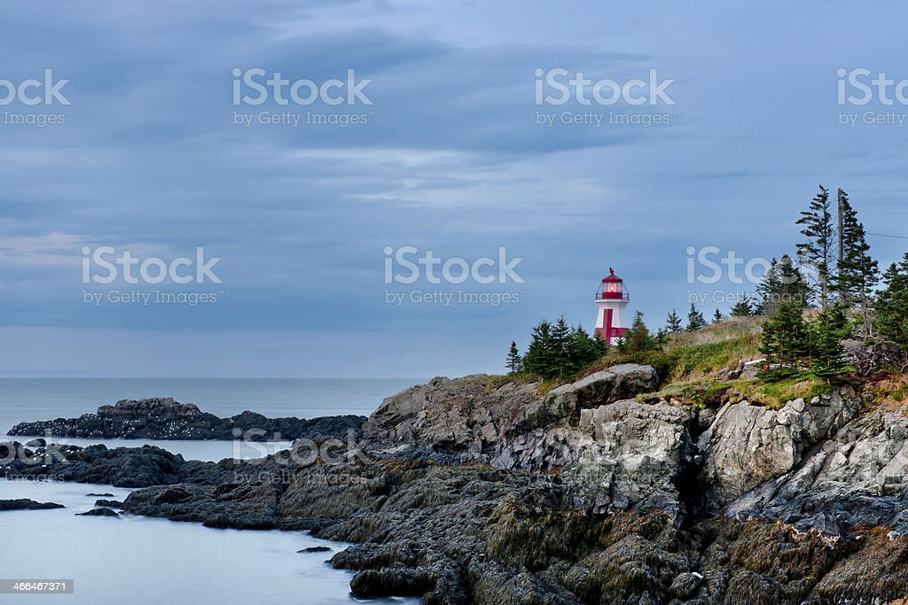 View of the East Quoddy Head Lighthouse and sea line East Quoddy Head Lighthouse, New Brunswick. Atlantic Ocean Stock Photo