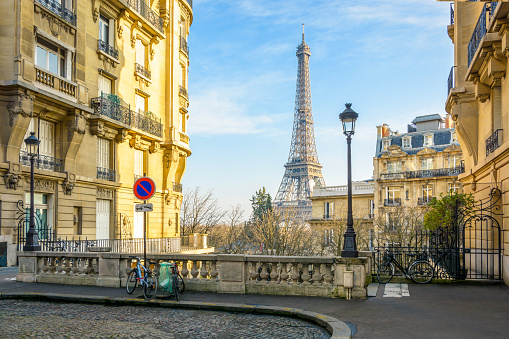 View of the Eiffel Tower from a small cobbled dead-end street of the Chaillot hill by a sunny winter afternoon