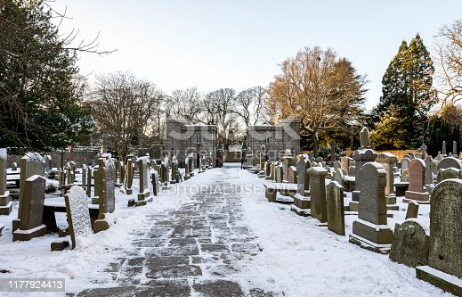 A view of the entrance stone gate to St Machar's Cathedral from inner cemetery in winter, Aberdeen, Scotland, December 2017. Photo was taken in the morning after unusual heavy snowfall in the city.