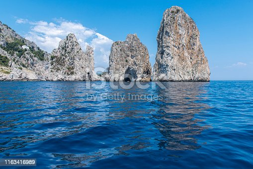 View of the Faraglioni, located in the of the Island of Capri in the Tyrrhenian Sea in Italy. This are rock formations eroded by the wind and water.