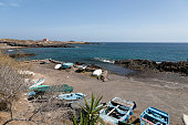 View of the fishing boat parking at the Playa de Los Abriguitos beach on the island of Tenerife, Canaries