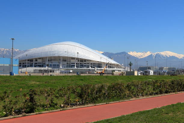 View of the Fisht stadium from the Olympic embankment. Russia Adler, Russia - April 4, 2017: View of the Fisht stadium from the Olympic embankment. Sochi, Krasnodar Region, Russia 2014 stock pictures, royalty-free photos & images