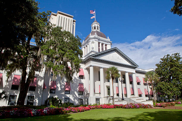 View of the Florida Stare Capitol in Tallahassee The old Florida State Capitol building as seen from Monroe St and Apalachee Parkway with the New Capitol in the background state capitol building stock pictures, royalty-free photos & images