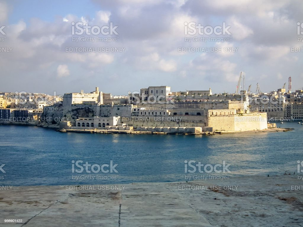 View of the Fort St. Angelo in Birgu from the Park Lower Barrakka Gardens in Valletta city, Malta stock photo