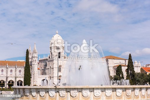 View of the fountain in Praça do Imperio and part of the Jeronimos Monastery at Lisbon city, Portugal. Located in the Belem district the monastery is an Unesco World Heritage site.