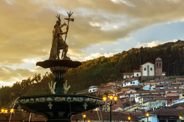 view of the fountain with san cristobal church in the background. plaza de armas, cusco, peru, south america - empire stock pictures, royalty-free photos & images
