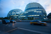 Beijing, China - June 1, 2013: The Galaxy SOHO building was officially opened and the opening ceremony was held at it, attracting many people to visit. The Galaxy SOHO was designed by Zaha Hadid Architects.