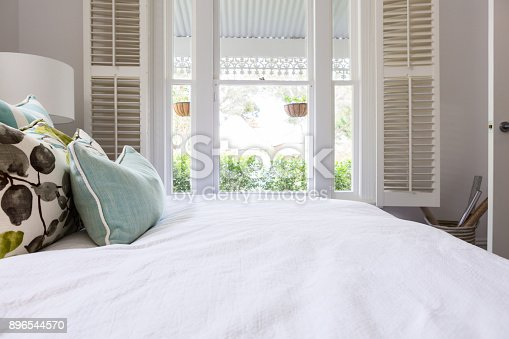 istock View of the garden from a luxury styled master bedroom 896544570