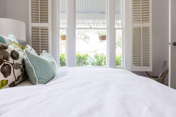 View of the garden from a luxury styled master bedroom - foto stock