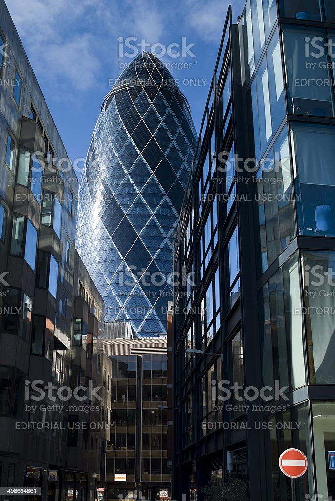 View of 'The gherkin' skyscraper from the neighbouring streets, London stock photo