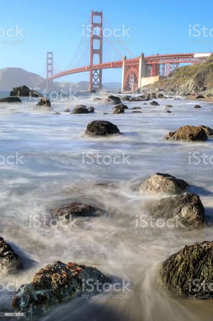 View of the Golden Gate Bridge from Rugged Marshall Beach in High Tide. royalty-free stock photo