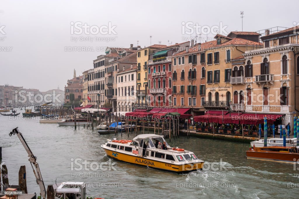 View of the Grand Canal from the Ponte di Rialto Bridge. On the waterfront there are street restaurants. stock photo
