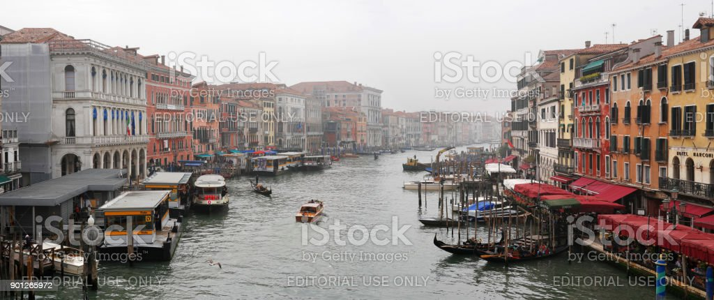 View of the Grande Canal from the Ponte di Rialto Bridge. Venice. Italy. A foggy day. In the water area you can see gondolas, pleasure boats. stock photo
